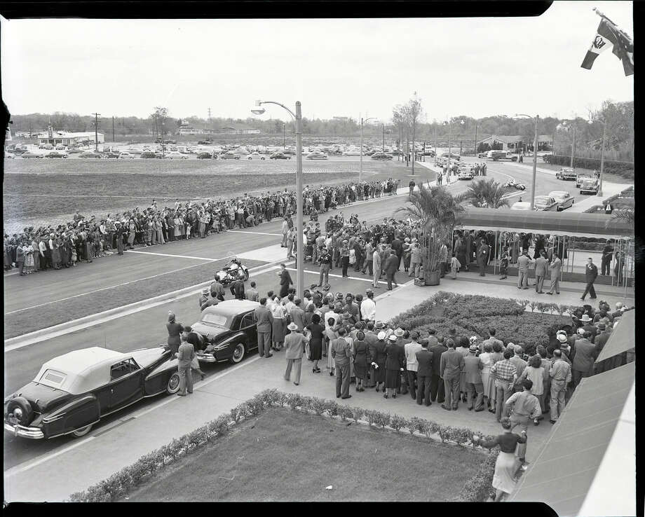 March 1949: Onlookers watch as photographers record ribbon cutting ceremonies at the grand opening of the Shamrock Hotel. Photo: HP Staff / Houston Post files
