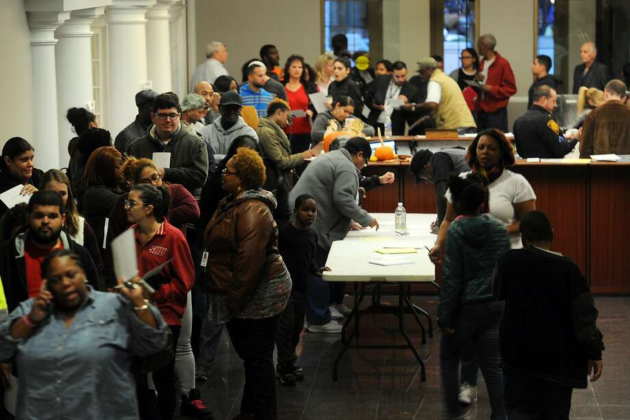 Hundreds of people wait in line to register and to vote on Election Day at the Morton Government Center, in Bridgeport, Conn. Nov. 8, 2016. Photo: Ned Gerard, Hearst Connecticut Media
