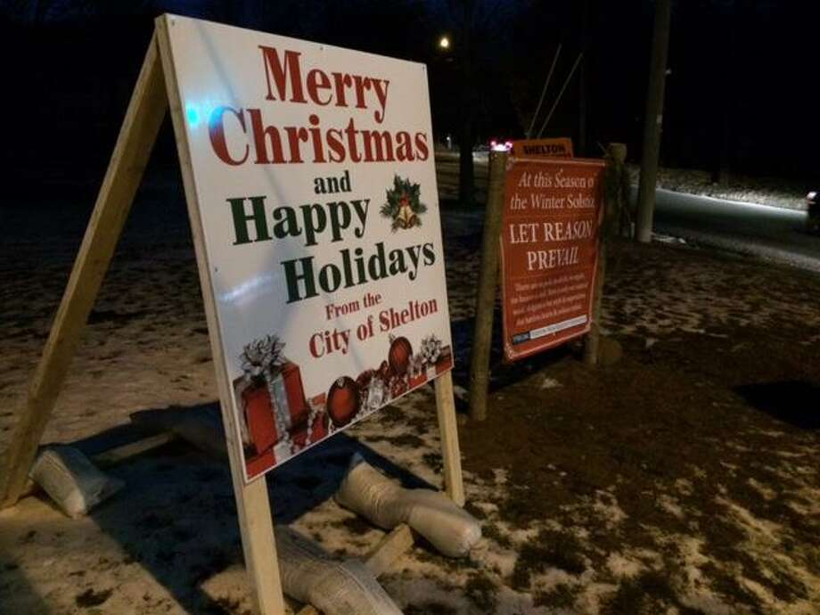 "Mayor Mark Lauretti placed a sign on the Huntington Green wishing residnets a Merry Christmas, in response to a sign by the Freedom From Religion group calling religion ""a myth and a superstition.'' Photo: John Burgeson"