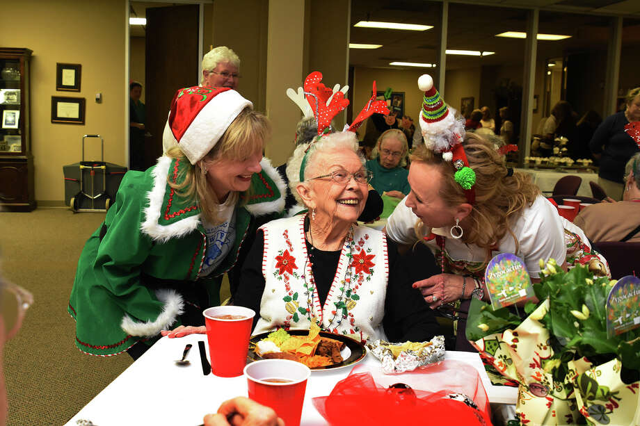 Maria Curry, left, and Jackie Macbeth greet senior LaVerne Pyron during a Fast Friends event. Members of The Cypress-Woodlands Junior Forum program Fast Friends are making efforts to establish friendships with seniors in the community. Photo: Tony Gaines