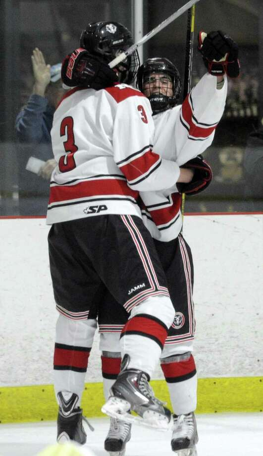 New Canaan George McMahon (3) and Brooks Gammill (25) celebrate McMahon's power play goal during the 2nd period of Saturday's 4-2 win over Notre Dame of West Haven at the Darien Ice House. Photo: Matthew Brown / Hearst Connecticut Media / Stamford Advocate