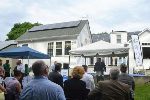 Bryan Garcia, President and CEO of the Connecticut Green Bank speaks at the home of Susan Young on Tuesday, July 21, 2015. Young's Bridgeport, Conn. home is one of the first in Connecticut to install solar power and other energy efficiency measures as part of an incentive program partnered by the Connecticut Green Bank and PosiDen.