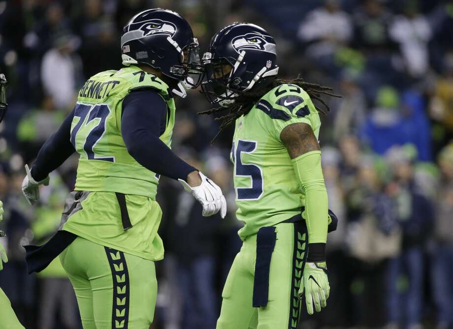 The Seahawks parted ways with defensive end Michael Bennett (left) on Wednesday, just over an hour after cornerback Richard Sherman (right) indicated he wasn't returning to Seattle in 2018. Photo: Elaine Thompson/AP