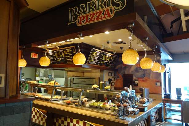 Barry's Pizza offers a margherita pizza slice, sausage and pepperoni stromboli and build-your-own salad ranging from $4.95 to $8.75 at Hobby Airport near gates 20 and 21. Photo provided by the Houston Airport System.