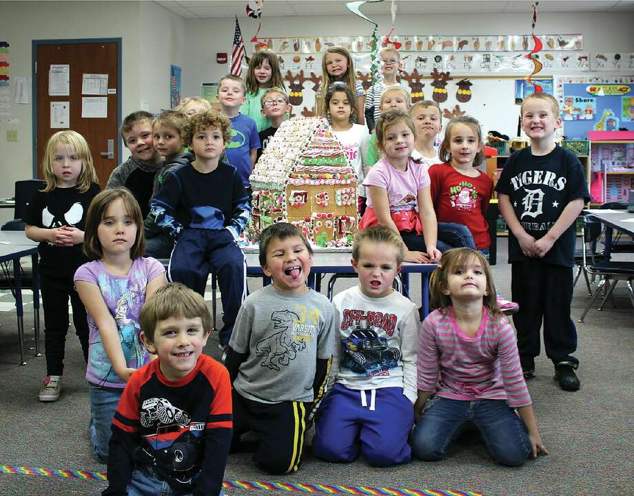 The DK class poses with the large gingerbread house they decorated over the course of just a couple of days. The finished house was donated to a senior living facility in Pigeon.  Photo: Laker Elementary Photo