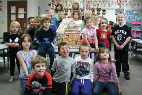 The DK class poses with the large gingerbread house they decorated over the course of just a couple of days. The finished house was donated to a senior living facility in Pigeon.