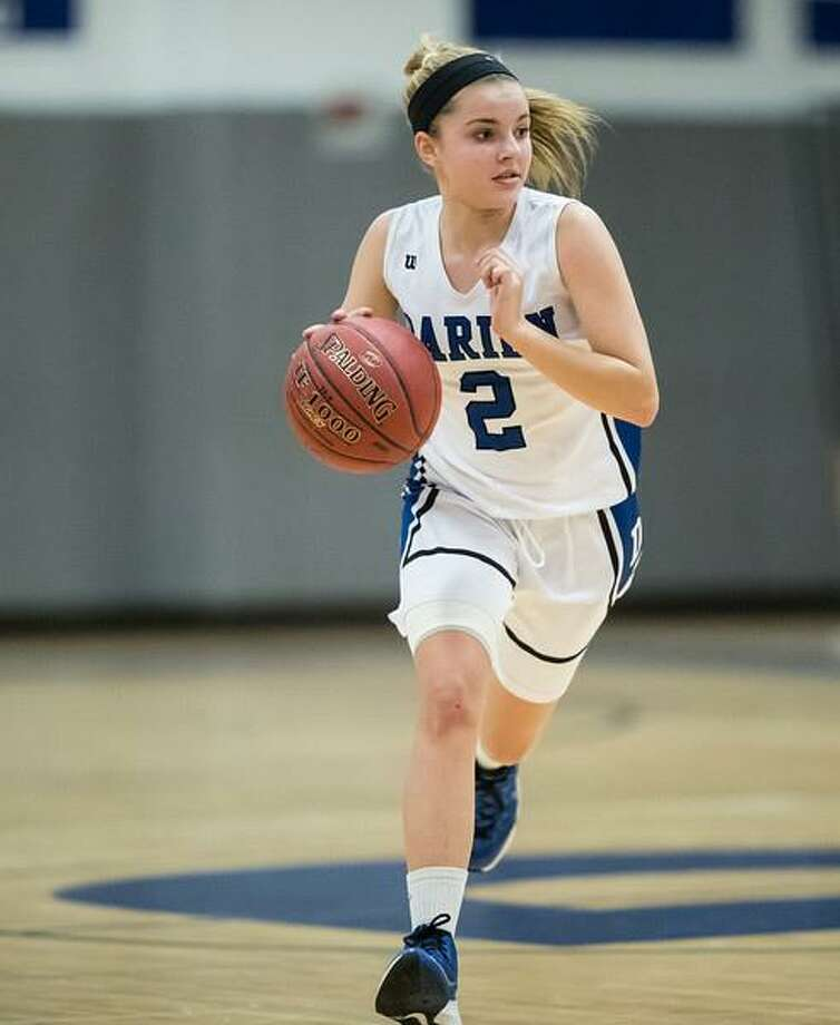 Darien freshman Ashley Humphrey dribbles up the court. Humphrey led all scorers with 19 points in Darien's 57-24 win over New Canaan last Wednesday. Photo: Mark Maybell / Contributed Photo / Darien News contributed