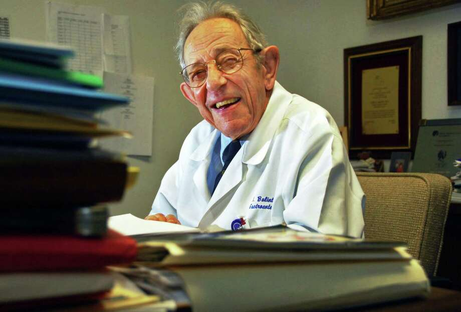 JOHN CARL D'ANNIBALE/TIMES UNION--   Dr. John Balint, Albany Medical Center gastroenterologist, professor and medical ethicist, who's  84 and has decided to retire from seeing patients after 60 years, in his Medical College office in Albany Tuesday morning February 17, 2009.    FOR GRONDAHL STORY Photo: John Carl D'Annibale / 00002434B