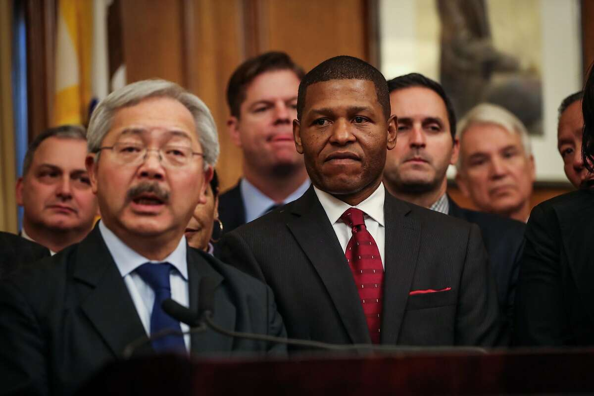 Mayor Ed Lee announced the new San Francisco police chief as William Scott (center) a veteran Los Angeles deputy chief, listened during a press conference at City Hall, in San Francisco, Calif., on Tuesday, Dec. 20, 2016.
