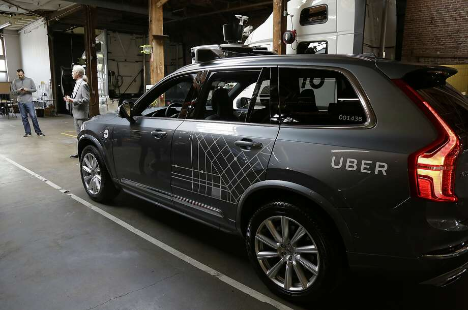 An Uber driverless car is displayed in a garage in San Francisco on Dec. 13. The ride-hailing company is refusing to obey demands by the state's Department of Motor Vehicles that it stop picking up San Francisco passengers in specially equipped Volvo SUVs. Hours after Uber launched the self-driving service Wednesday, Dec. 14, the DMV warned it was illegal because the cars did not have a special permit. (AP Photo/Eric Risberg) Photo: Eric Risberg, Associated Press