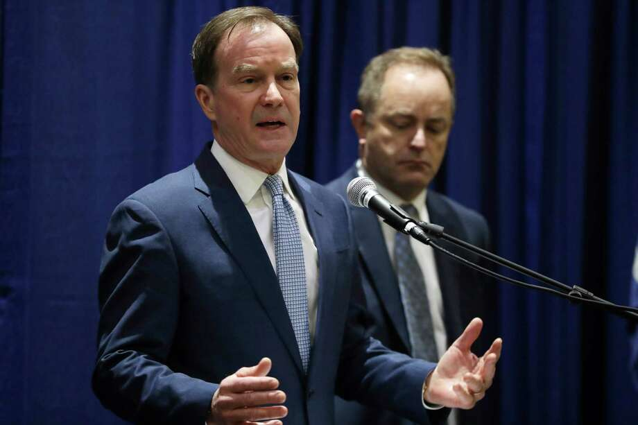 Michigan Attorney General Bill Schuette addresses a news conference, Tuesday, Dec. 20, 2016, in Flint, Mich., where he charged two former State of Michigan Emergency Managers, Darnell Earley and Gerald Ambrose, with multiple 20-year felonies for their failure to protect the citizens of Flint from health hazards cased by contaminated drinking water. Schuette also charged Earley, Ambrose and Flint city employees Howard Croft and Daugherty Johnson with felony counts of false pretenses and conspiracy to commit false pretenses in the issuance of bonds to pay for a portion of the water project that led to the crisis. (AP Photo/Carlos Osorio) Photo: Carlos Osorio, STF / Copyright 2016 The Associated Press. All rights reserved.
