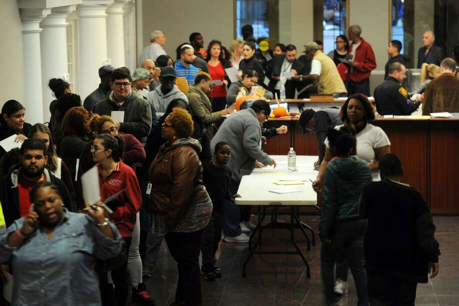 Hundreds of people wait in line to register and to vote on Election Day at the Morton Government Center, in Bridgeport, Conn. Nov. 8, 2016. Photo: Ned Gerard / Hearst Connecticut Media / Connecticut Post