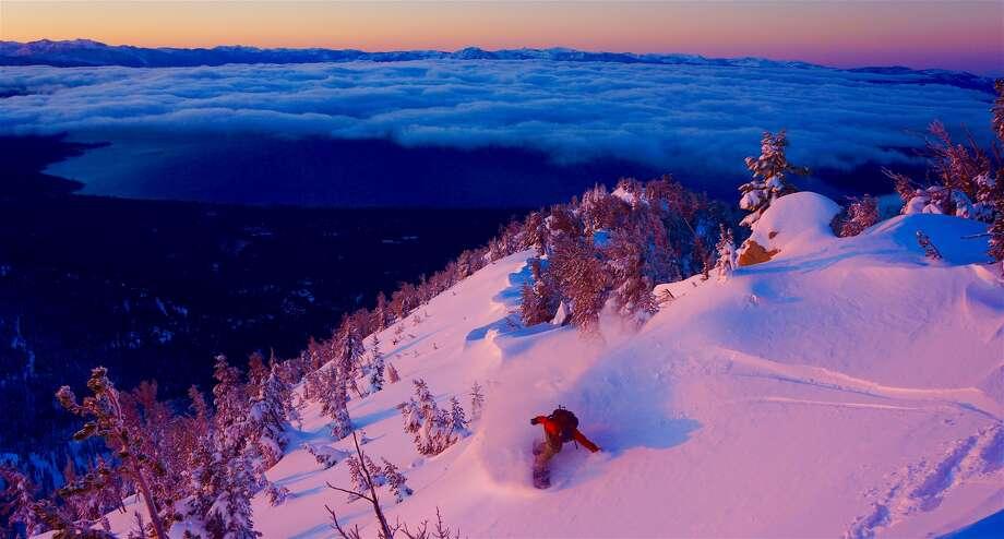Photo: Brennan Lagasse  Rider: Jeremy Jones high above Lake Tahoe on a beautiful sunrise backcountry tour