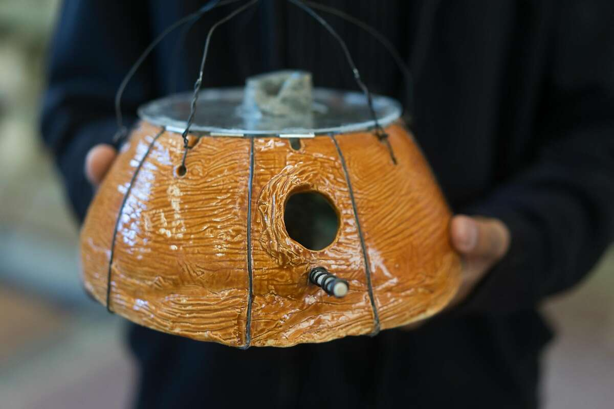 """Arnold Seng poses with his birdhouse """"River Bowl"""" at Mt. Eden High School in Hayward, Calif. on Tuesday, Dec. 20, 2016. Students at two high schools have built birdhouses to auction off in January to see who will raise the most money."""