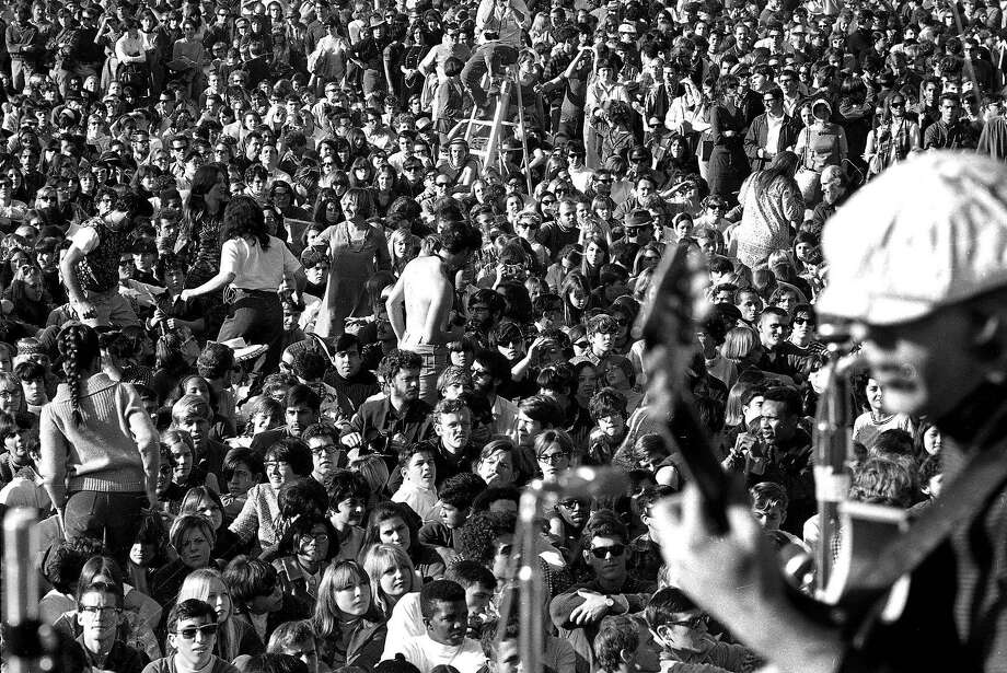 ** ADVANCE FOR USE SUNDAY, JAN 14, 2007 ** A large crowd enjoys live music at Golden Gate Park in this fille photo taken Saturday, Jan. 14, 1967. In many ways, the '60s as we know them began on Jan. 14, 1967. And while the decade may have a new meaning for a cohort contemplating retirement, those who were in Golden Gate Park that day a generation still talking about itself agreed that neither they nor San Francisco have been the same since. (AP Photo) Photo: AP