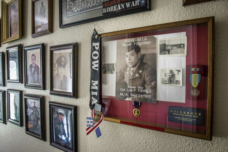 """Gregorio Torres, a Vietnam veteran, poses with a photograph of his brother, Luis Patlan Torres, who went missing in action during his tour in Korea in 1950, at his home on Thursday, September 22, 2016. After 1950, Corporal Luis Patlan Torres was determined to be a prisoner of war, and in 1954 was declared dead by the Department of Defense. His remains were unidentified until the DOD identified him through bone records. The Torres family was notified on July 21 of this year, 66 years after he went missing, and they are awaiting the return of his remains to San Antonio, where he will be buried at Fort Sam Houston National Cemetery. """"I'm more at peace knowing he's on his way home,"""" Gregorio Torres said. Photo: Matthew Busch /For The San Antonio Express-News / © Matthew Busch"""