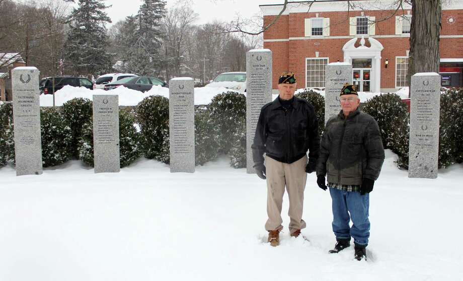 Wilton veterans Alex Ruskewich and Franklin Dunn in front of the Veterans Memorial Green on Saturday, Dec. 16. Photo: Stephanie Kim / Hearst Connecticut Media