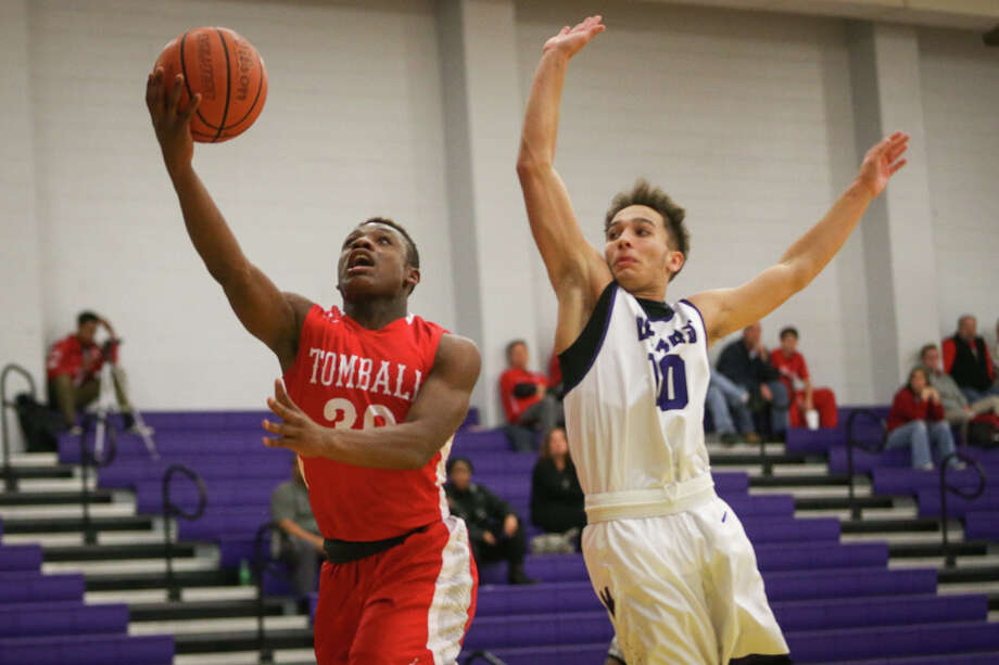 Tomball's Tybo Taylor (30) shoots as Montgomery's Grant Bowers (10) defends during the varsity boys basketball game on Tuesday, Dec. 20, 2016, at Montgomery High School. (Michael Minasi / Chronicle) Photo: Michael Minasi, Staff / © 2016 Houston Chronicle