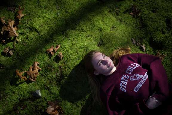 Jade Blouin, 16, faces the afternoon light at the backyard of her mother's home in State College, Saturday, Nov. 12, 2016. Blouin and her family moved to Pennsylvania to provide special education for her.