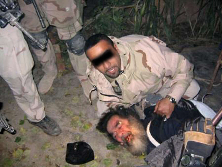 This unsourced picture allegedly shows ousted Iraqi leader Saddam Hussein being dragged out of his hiding following his capture by US troops 13 December 2003 in an underground hole at a farm in the village of ad-Dawr, near his hometown of Tikrit in northern Iraq.        AFP PHOTO/HO (Photo credit should read /AFP/Getty Images) Photo: Getty Images