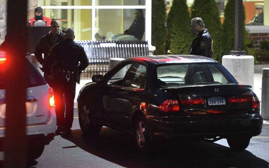 Norwalk police investigate a honda sedan left at the entrance to the emergency room at Norwalk Hospital, allegedly driven there by a victim of gunshots on Tuesday December 20, 2016 in Norwalk Conn Photo: Alex Von Kleydorff / Hearst Connecticut Media / Connecticut Post