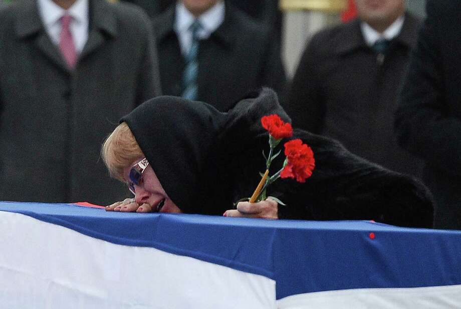 Marina Karlov mourns over the coffin holding her husband, Russian Ambassador to Turkey Andrei Karlov, before it is carried to a plane during a ceremony at Esenboga airport in Ankara. Turkey. Russia's ambassador to Turkey, Andrey Karlov, was shot dead by a Turkish policeman shouting 'Don't forget Aleppo! Don't forget Syria' at an art exhibition in the Turkish capital of Ankara yesterday.  (Photo by Erhan Ortac/Getty Images) *** BESTPIX *** Photo: Erhan Ortac, Stringer / 2016 Getty Images