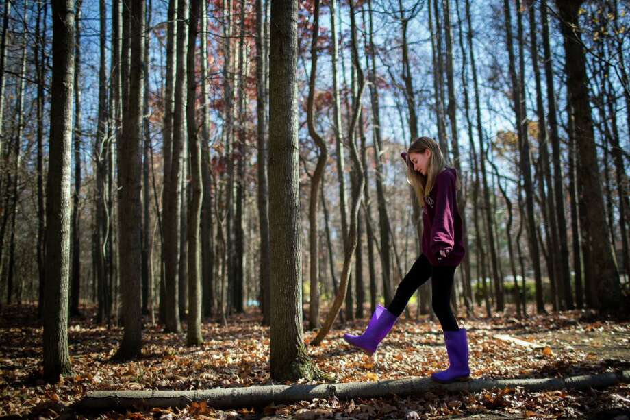 Jade takes a walk through the woods near her parents home in Pennsylvania. Photo: Marie D. De Jesus, Houston Chronicle / © 2016 Houston Chronicle