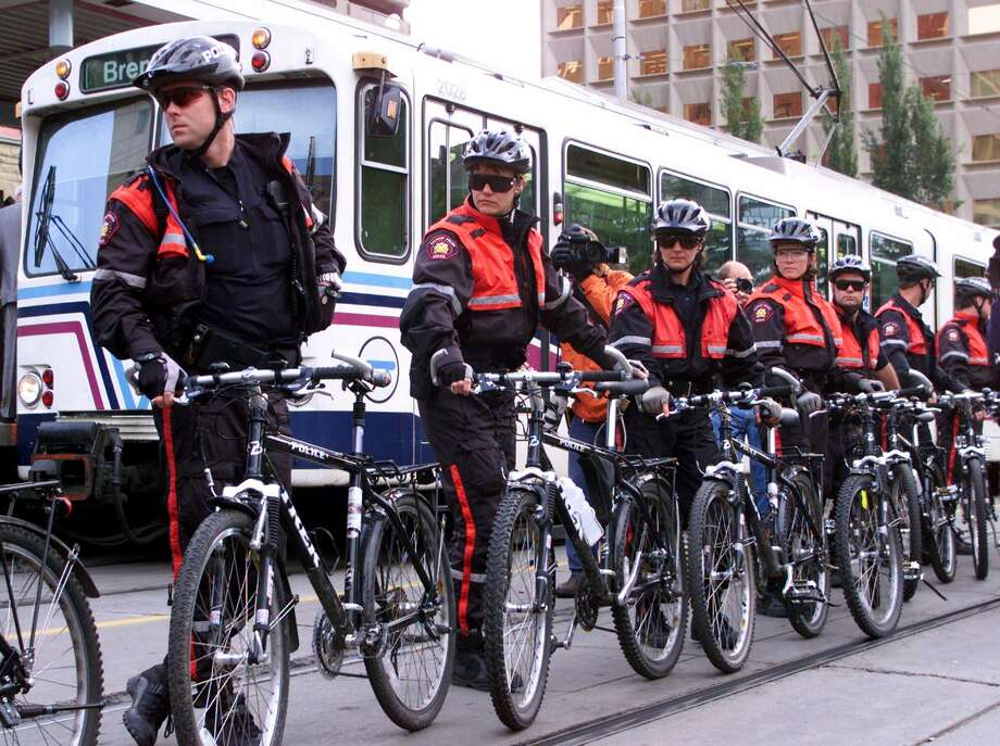 Police form a barricade to keep protesters from blocking a commuter train at the 2000 World Petroleum Congress in Calgary, Alberta. Photo: ADRIAN WYLD, SUB / CP