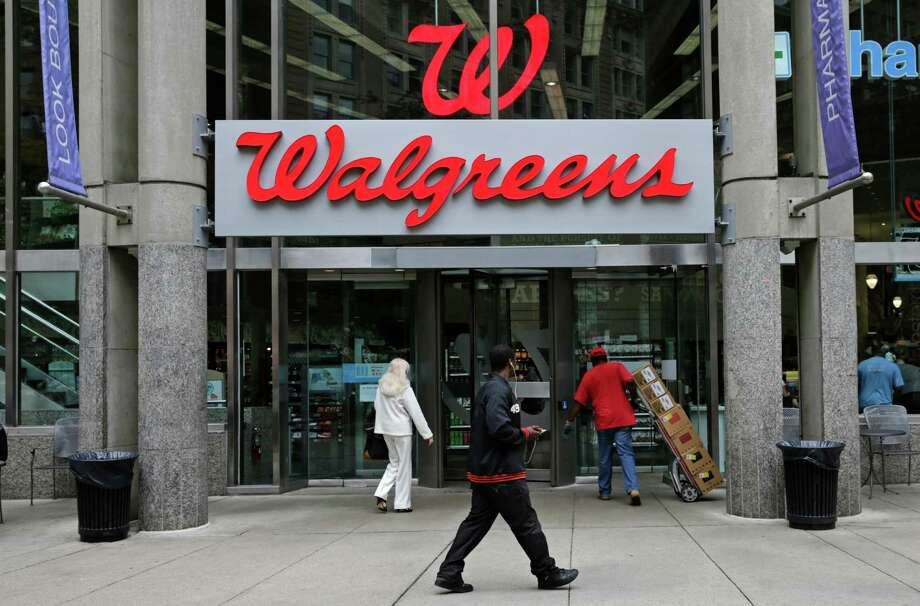FILE - This June 4, 2014, file photo, shows a Walgreens retail store in Boston. Walgreens and Rite Aid will sell 865 stores to rival retailer Fred's for $950 million, possibly removing the final roadblock preventing the tie up between the nation's largest and third-largest drugstore chains, in news announced Tuesday, Dec. 20, 2016. (AP Photo/Charles Krupa, File) Photo: Charles Krupa, STF / Copyright 2016 The Associated Press. All rights reserved. This material may not be published, broadcast, rewritten or redistribu