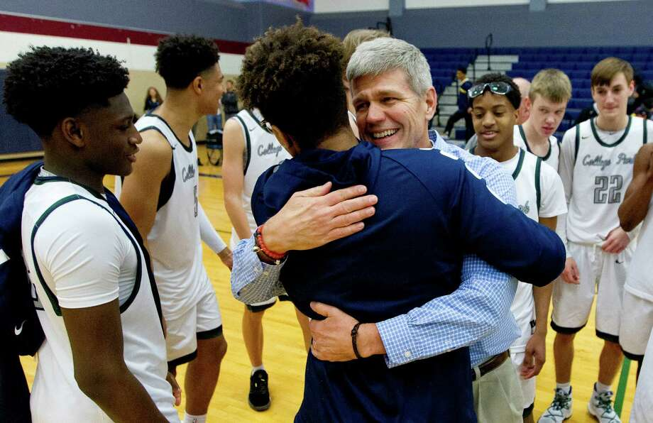 College Park head coach Clifton McNeely hugs players after Cavaliers defeated La Marque 85-59 for his 500th career win during the third quarter of a non-district high school boys basketball game at College Park High School Tuesday, Dec. 20, 2016, in The Woodlands. Photo: Jason Fochtman, Staff Photographer / Houston Chronicle