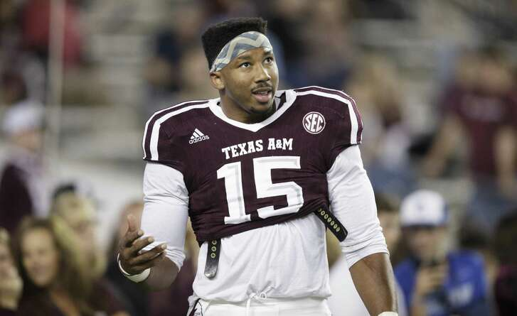 Texas A&M defensive lineman Myles Garrett (15) talks to teammates in between drills before the start of the game against Ole Miss on Nov. 12, 2016, in College Station.
