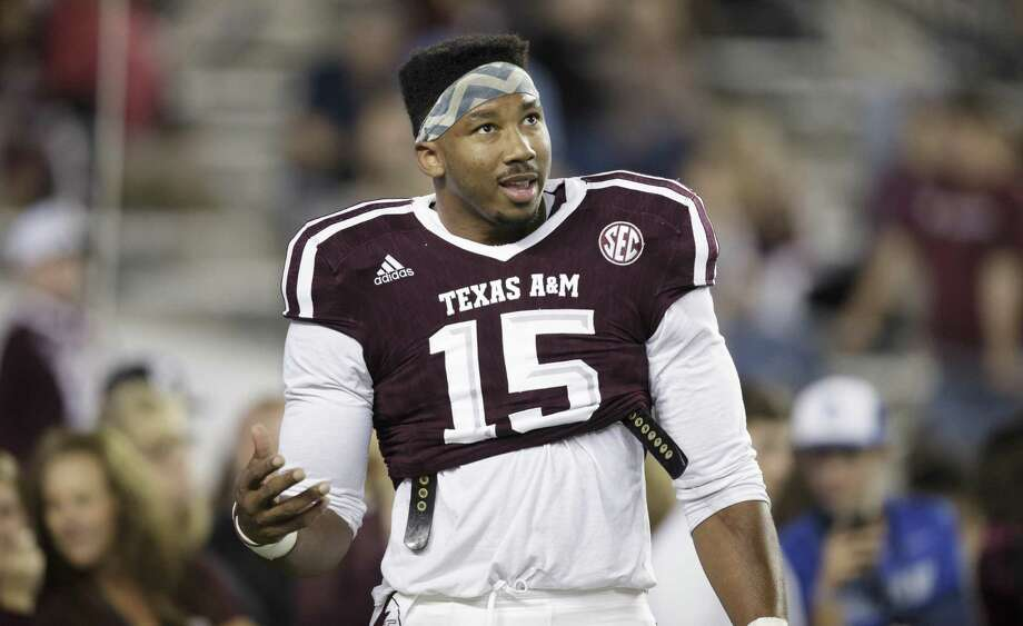 Texas A&M defensive lineman Myles Garrett (15) talks to teammates in between drills before the start of the game against Ole Miss on Nov. 12, 2016, in College Station. Photo: Sam Craft /Associated Press / AP