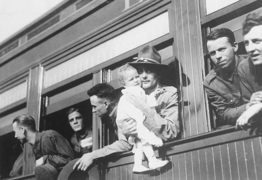 Life in 1917U.S. servicemen, one holding an infant, lean from train windows to say goodbye to loved ones as they get ready to leave for Europe to fight in World War I. Many would not return, and those who did would find a much different nation on the brink of becoming a world power.Click through the gallery to see other facets of life in 1917 in Texas and the United States. Photo: Time Life Pictures/Getty Images/Time & Life Pictures Creative