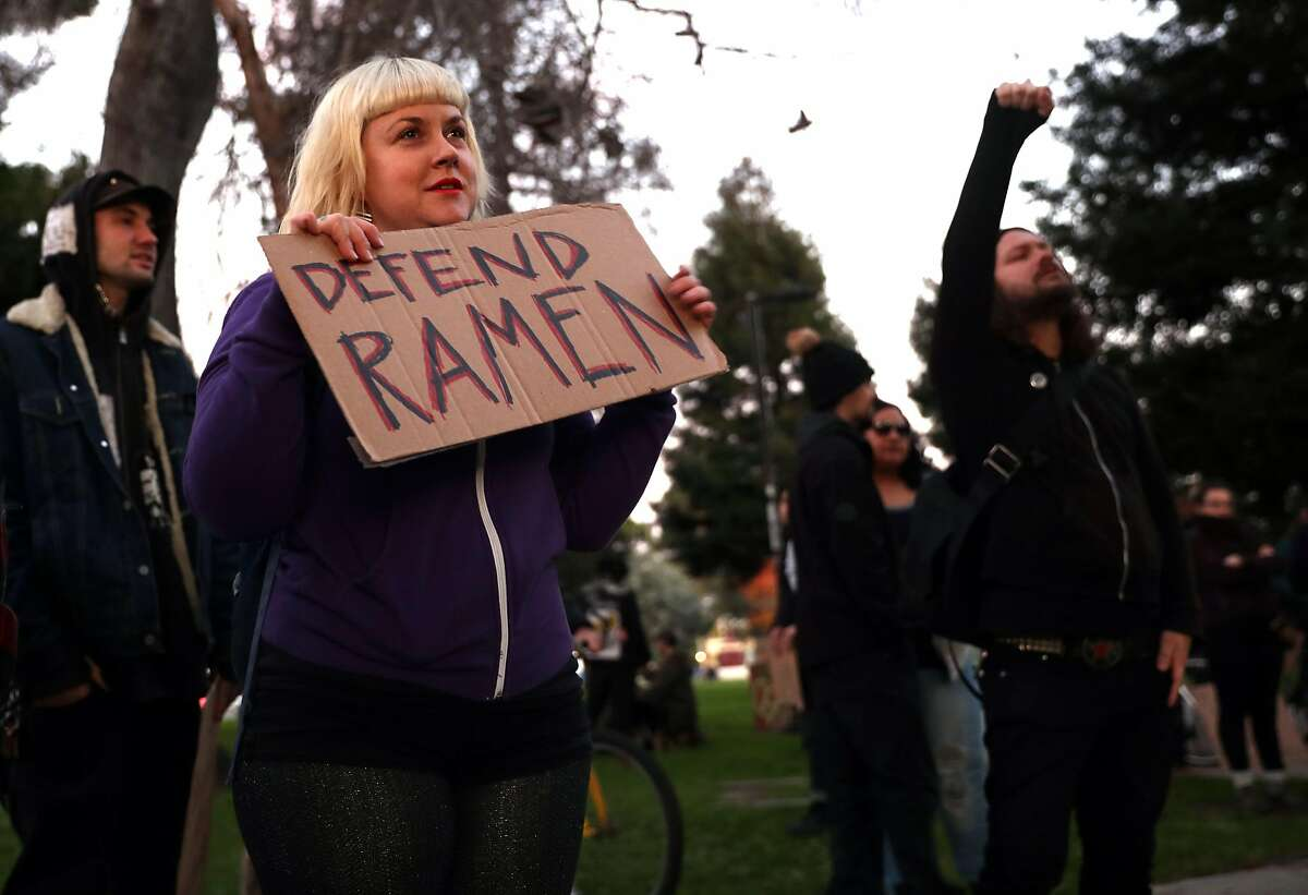 Erin Ruch holds a sign supporting Burnt Ramen warehouse venue as protesters prepare to march to City Council meeting in Richmond, Calif., on Tuesday, December 20, 2016.