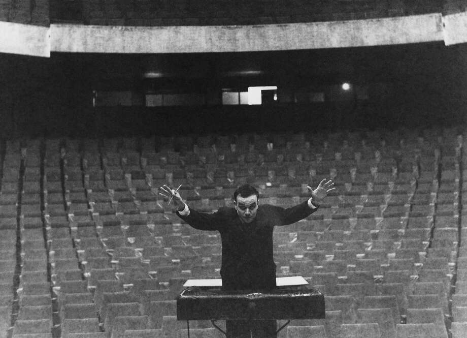 Yves Klein conducts an imaginary orchestra in 1959 in Germany. Photo: Charles Wilp, BPK, Berlin