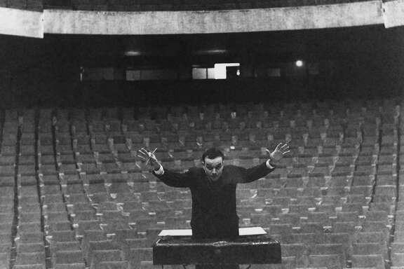 Yves Klein conducting his Symphonie Monoton in front of an imaginary orchestra, Gelsenkirschen�s Opera House, 1959.  � Yves Klein, ADAGP, Paris / ARS, New York, 2016  � Photo Charles Wilp, BPK, Berlin