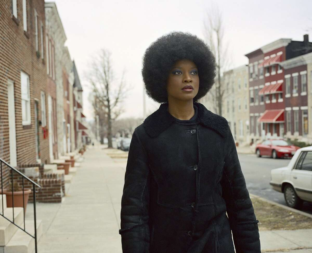 Isaac Julien Baltimore Series (Angela in Blue, No.1), 2003 Framed digital print on Epsom Premium Photo Glossy paper 40 1/8 x 49 1/4 in.