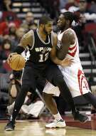 San Antonio Spurs' LaMarcus Aldridge (12) is guarded by Houston Rockets' Montrezl Harrell during the first half of an NBA basketball game Tuesday, Dec. 20, 2016, in Houston. (AP Photo/David J. Phillip)