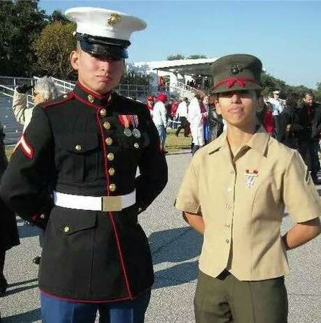 Marine Enrico Rojo, seen with his sister and fellow Marine Krystal Revels-Rojo, was struck and killed while trying to help a motorist in California on Monday. Rojo and his fiancee were on their way to L.A.'s airport to catch a flight to Houston. Photo: Family Photo / family photo