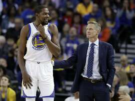 Golden State Warriors' Kevin Durant, left, talks with head coach Steve Kerr during the first half of an NBA basketball game against the Los Angeles Lakers Wednesday, Nov. 23, 2016, in Oakland, Calif. (AP Photo/Marcio Jose Sanchez)