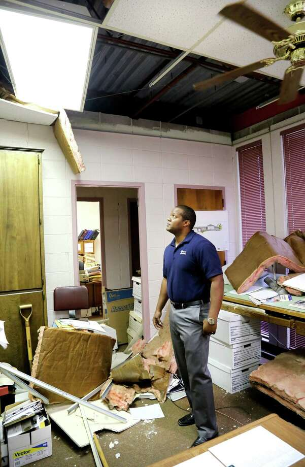 Jeremy Frazier, Cushing assistant city manager, stands in his office littered with insulation, ceiling tiles and debris after Sunday night's 5.0 magnitude earthquake in Cushing, Okla. Frazier said it was a strong quake. He felt it at home which is only three blocks from city hall. (Jim Beckel The Oklahoman via AP) Photo: Jim Beckel, MBI / The Oklahoman