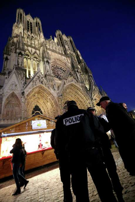 French officers patrol a Christmas market in Reims on Tuesday. Security was beefed up across Europe after a truck tore into a Berlin market, killing 12. Photo: FRANCOIS NASCIMBENI, Stringer / AFP or licensors