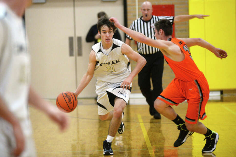 ERIN KIRKLAND | ekirkland@mdn.net  Bullock Creek's Travis Radosa dribbles the ball down the court on Tuesday at Bullock Creek High School.