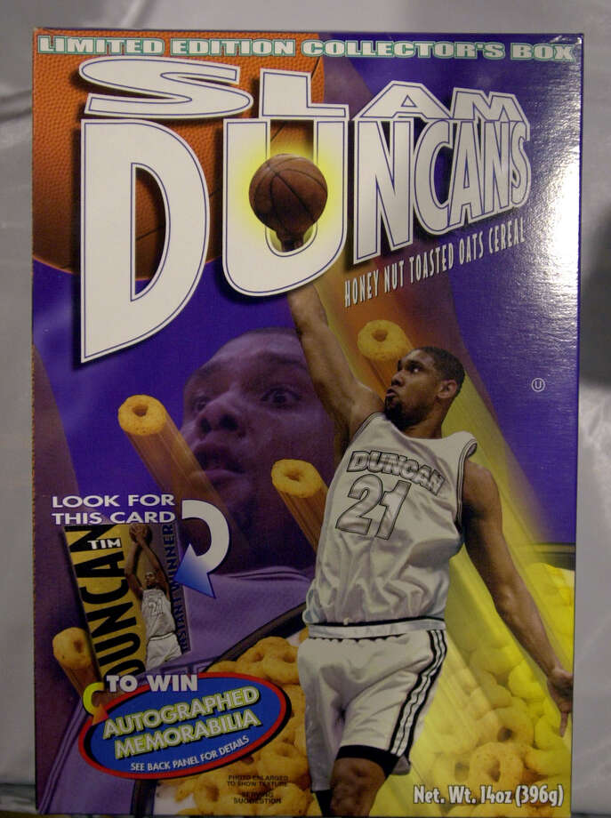 """Tim Duncan's new cereal """"Slam Duncans"""" at a H.E.B grocery store in San Antonio, Texas April 6, 2000. The honey-nut toasted oats cereal, produced and distributed by New York-based Famous Fixins Inc., is now available for $2.79 a box in San Antonio, and soon will be available in North Carolina, where Duncan attended and played college basketball at Wake Forest University, and the Virgin Islands, where he spent his childhood. A portion of the proceeds from the cereal's sales will be donated to the Children's Shelter of San Antonio. Photo by Edward A. Ornelas/STAFF Photo: EDWARD A. ORNELAS, STAFF / EN"""