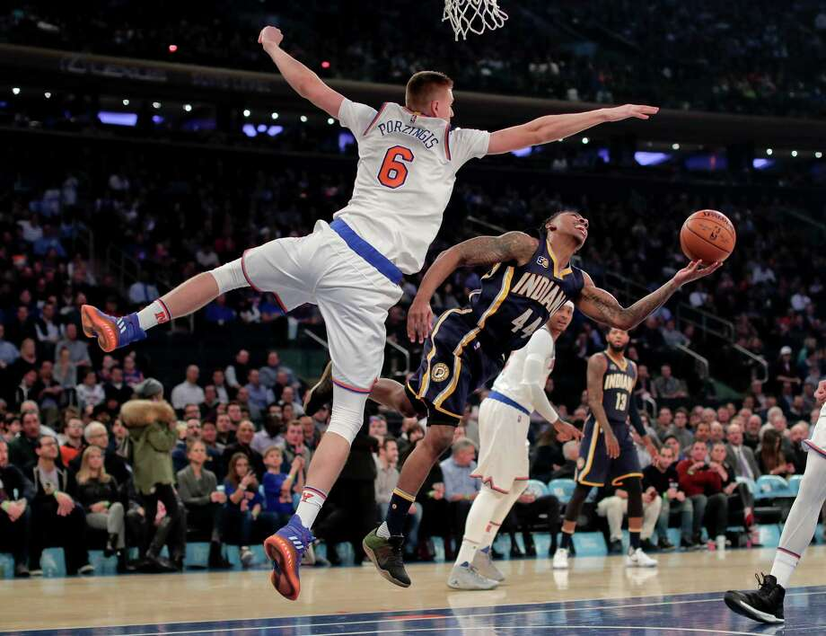 New York Knicks forward Kristaps Porzingis (6) forces Indiana Pacers guard Jeff Teague (44) to alter his shot during the first quarter of an NBA basketball game, Tuesday, Dec. 20, 2016, in New York. (AP Photo/Julie Jacobson) ORG XMIT: MSG101 Photo: Julie Jacobson / Copyright 2016 The Associated Press. All rights reserved.