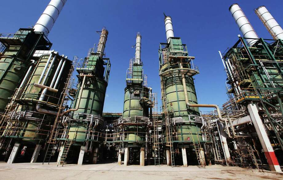 These refining towers are at Libya's Zawiya oil refinery near Tripoli. Libya is set to load its first crude cargo in two years from its largest export terminal. Photo: Shawn Baldwin / © 2011 Bloomberg Finance LP