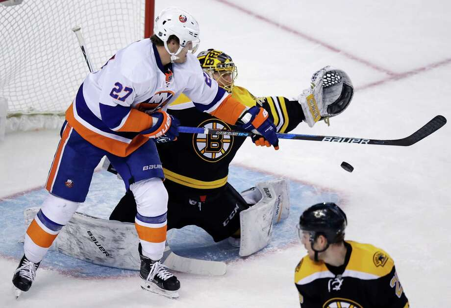 New York Islanders left wing Anders Lee (27) tips the puck down in front of Boston Bruins goalie Anton Khudobin, which set up his goal, during the third period of an NHL hockey game in Boston, Tuesday, Dec. 20, 2016. (AP Photo/Charles Krupa) ORG XMIT: MACK111 Photo: Charles Krupa / Copyright 2016 The Associated Press. All rights reserved.