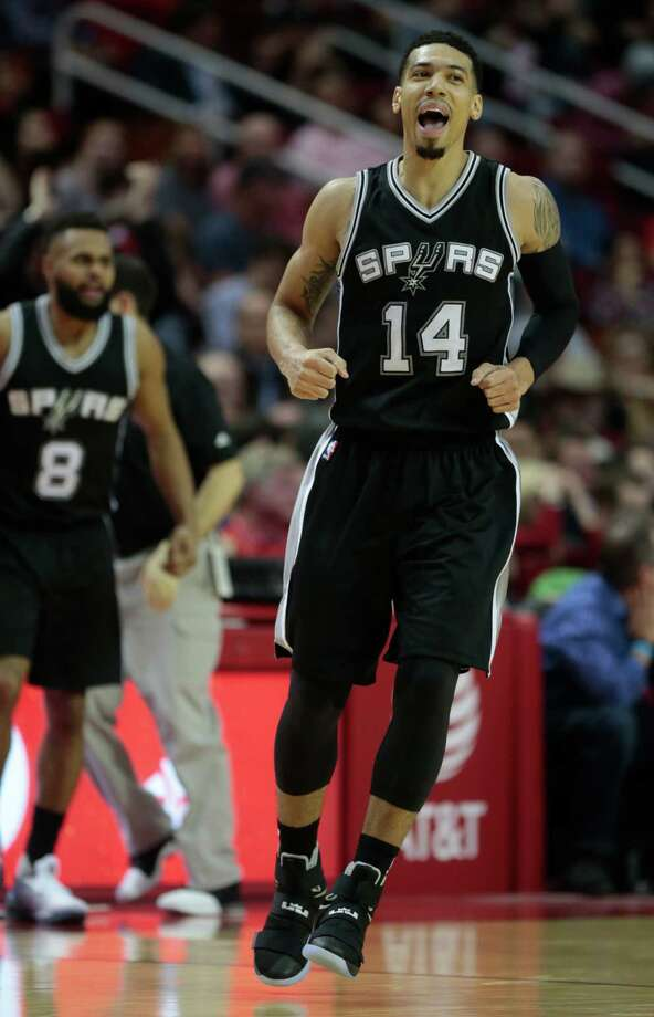Spurs guard Danny Green (14) is stoked after sinking a  fourth-quarter 3-pointer Tuesday night. All eight of his shots in the game were from long range, and he made four. Photo: Brett Coomer, Staff / © 2016 Houston Chronicle