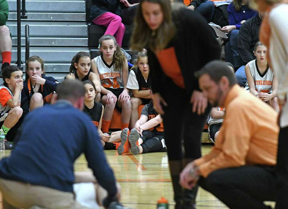 Young fans watch as Bethlehem's Maggie Kirby is attended to by staff following an injury during their girl's high school basketball game against Shenendehowa on Tuesday Dec. 20, 2016 in Delmar, N.Y. (Michael P. Farrell/Times Union) Photo: Michael P. Farrell / 20039183A