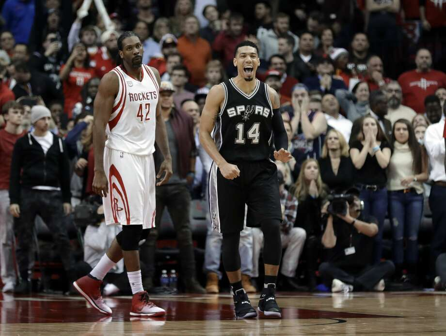 San Antonio Spurs' Danny Green (14) celebrates as Houston Rockets' Nene Hilario (42) walks behind during the closing seconds of an NBA basketball game Tuesday, Dec. 20, 2016, in Houston. The Spurs won 102-100. (AP Photo/David J. Phillip) Photo: David J. Phillip/Associated Press
